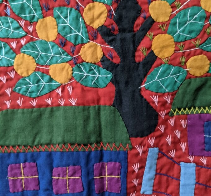 Colorful patterns on a quilt from Ecuador